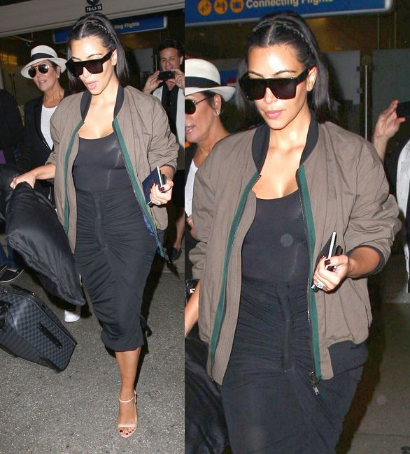 kim-kardashian-landing-lax-from-riccardo-tisci-birthday-party-in-ibiza-wearing-givenchy-tapered-skirt