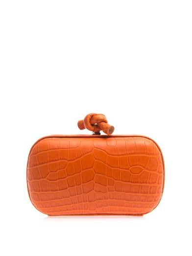Bottega-Veneta-knot-cocodrile-sking-orange-clutch-bag
