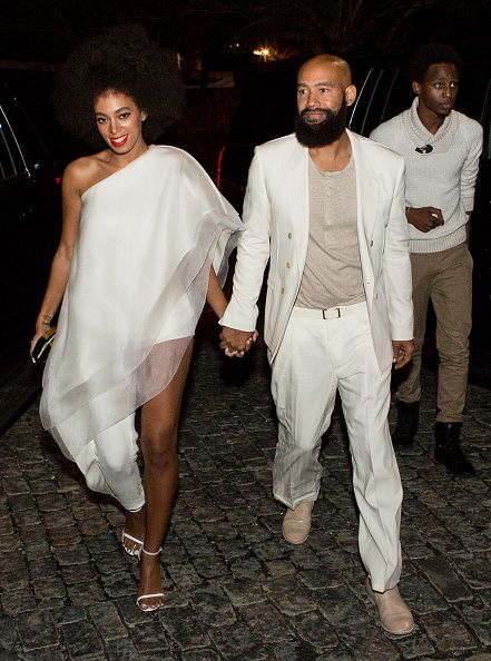 Solange Knowles (wearing Stephane Rolland with Stuart Weitzman shoes and a Lee Savage clutch) and her fiancee, music video director Alan Ferguson (wearing Costume National with an H&M shirt and Maison Martin Margiela shoes), arrive for their rehearsal dinner at the Felicity Street Methodist Church on November 15, 2014 in New Orleans, Louisiana.