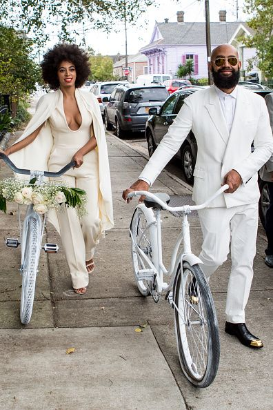 Solange Knowles (wearing a pre-ceremony ensemble by Stephane Rolland) and her fiancee, music video director Alan Ferguson ride bicycles on the streets of the French Quarter en route to their wedding ceremony at the Marigny Opera House on November 16, 2014 in New Orleans, Louisiana.