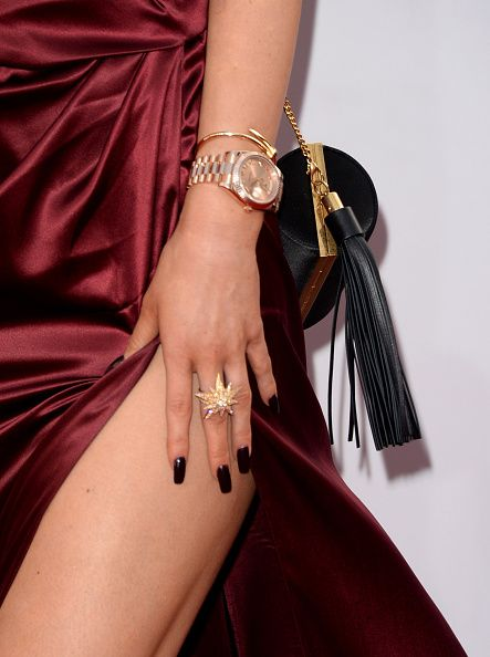 Her ring is Ileana Makri and her fringed bag by Alexander McQueen