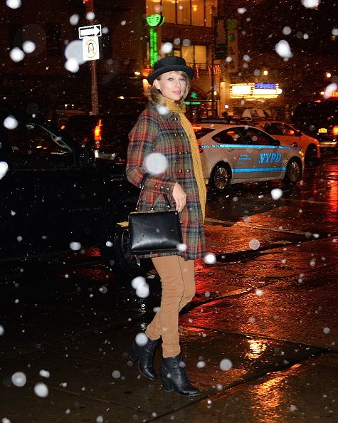 Taylor Swift in a Free People cocoon coat walking walking in Soho in the snow on December 10, 2014 in New York City.