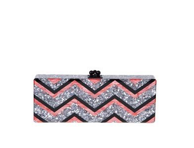 She's also carrying an Edie Parker Flavia chevron confetti clutch bag