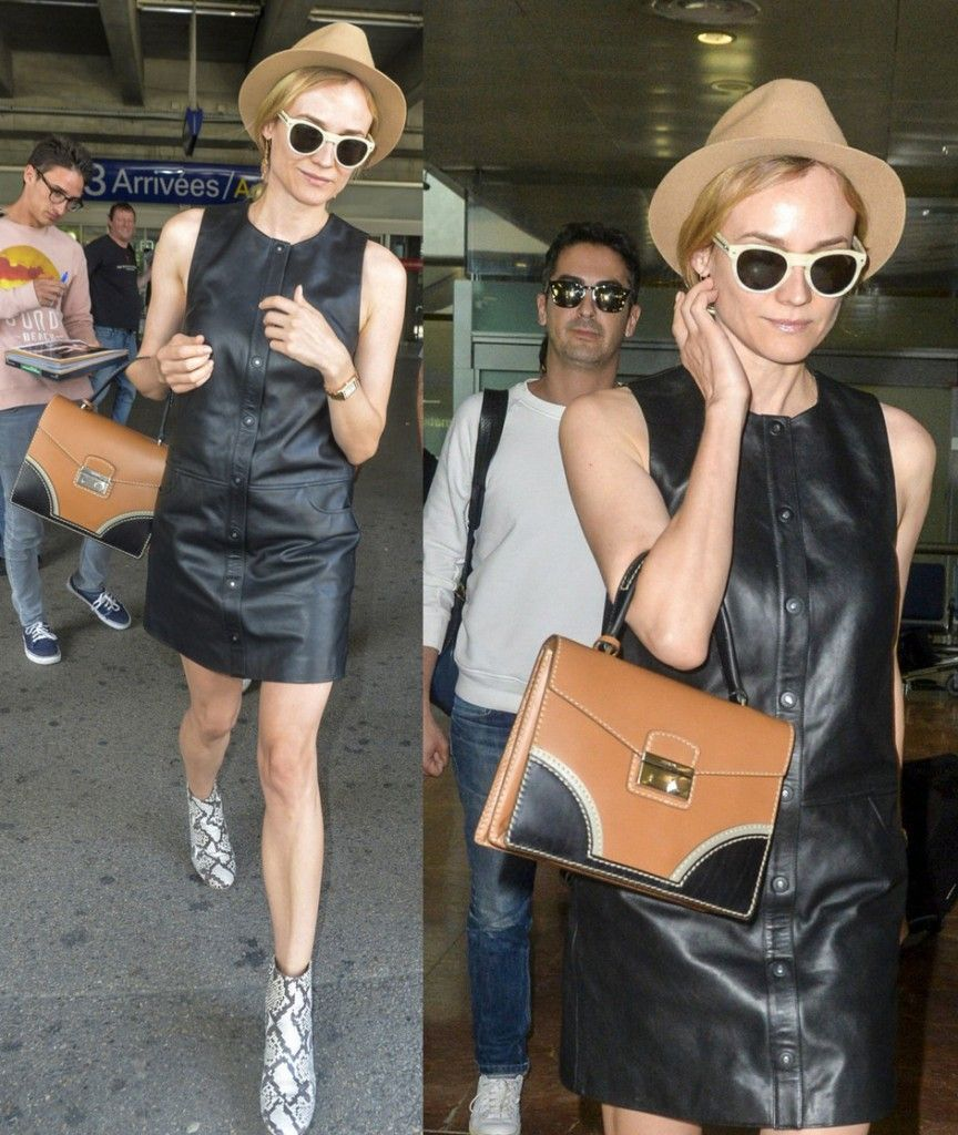 Diane Kruger landing at Cannes whike carrying a Prada Vachetta bicolor shoulder bag available at SAKS