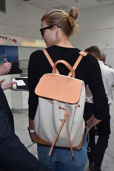 Karlie is carrying a  Mansur Gavriel backpack. You can buy the bucket bag version at MATCHESFASHION.com