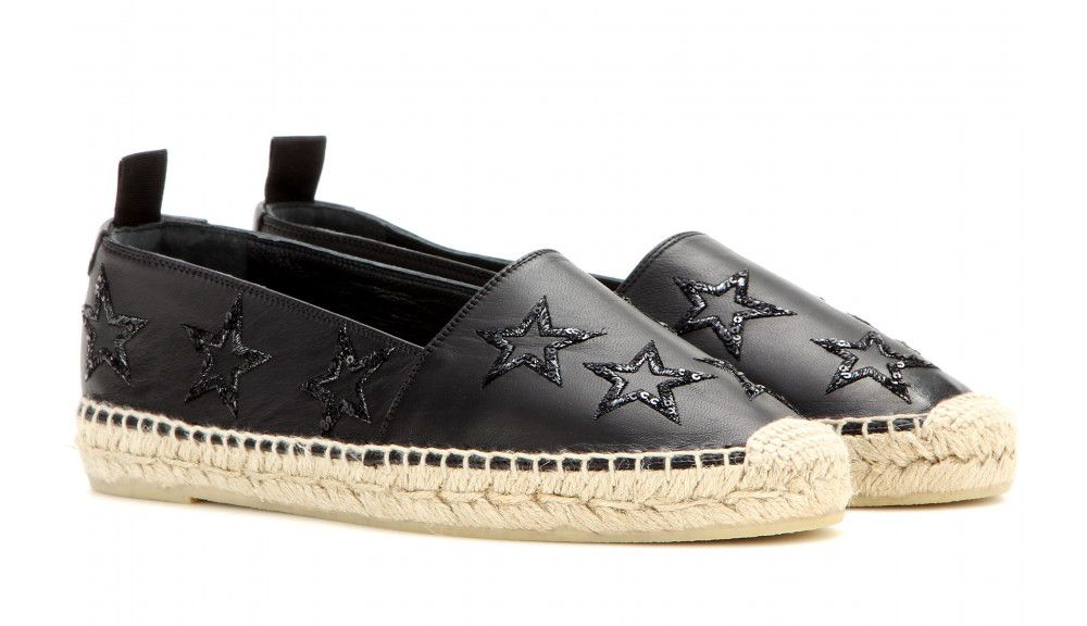 Saint Laurent star-embellsihed black leather espadrilles available at MYTHERESA.com