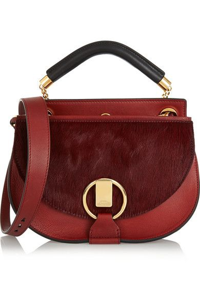 This Goldie oxblood leather and calf-hair bag is available at NET-A-PORTER