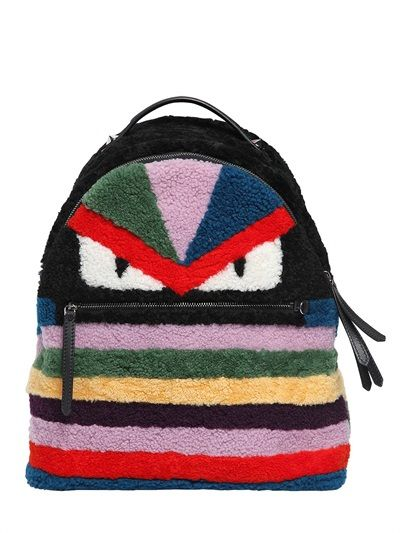 7ac51e7d8692 Kylie s Fendi Monster multicolored shearling backpack is available at  LUISAVIAROMA.COM and NEIMAN MARCUS