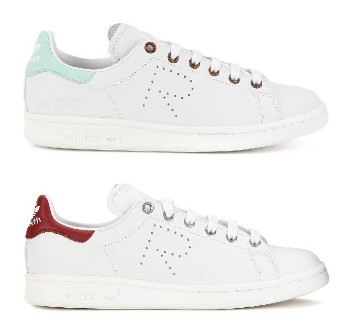 Adidas by Raf Simons Stan Smith sneakers features a dark red stitched logo tab to the back and perforated detailing at the sides
