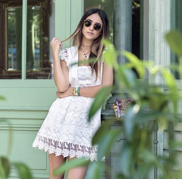 Soraya Bakhtiar is wearing a Self-Portrait ruffled guipure lace mini dress available at NET-A-PORTER