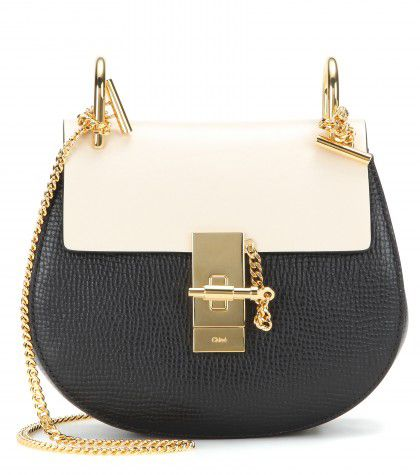 Black grainy leather with contrasted cream flap shoulder bag available at MYTHERESA.com