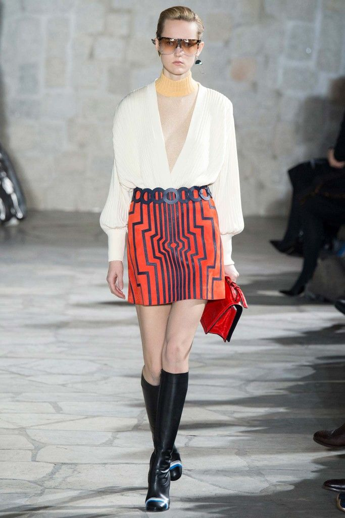LAIA'S PICK: Loewe red suede cyborg miniskirt available at MYTHERESA.com