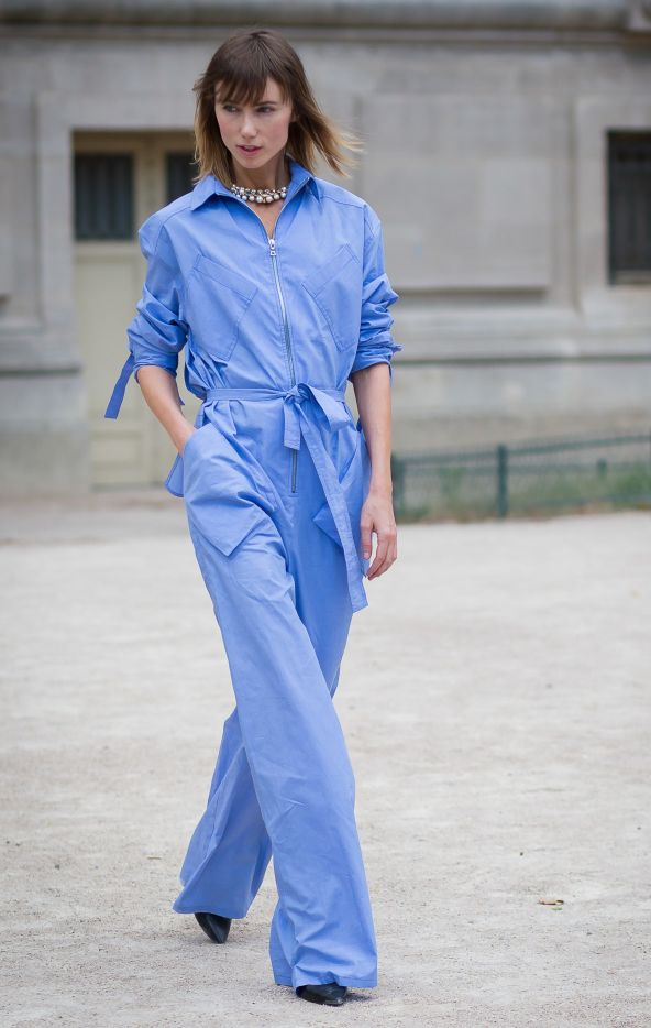 Anya Ziourova wearing the same Rosie Assoulin boiler suit as Leandra, out in Paris for Fashion Week.
