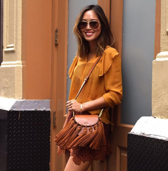 Aimee carrying the Hudson Mini with suede tassels around New York.