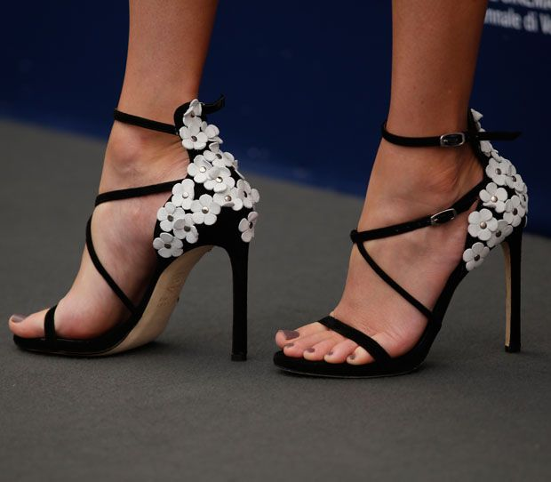 Elizabeth's sandals are Stuart Weitzman