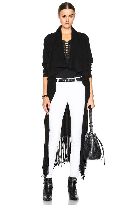 Chiara's black cashmere fringe cardigan is available at FORWARD BY ELYSE WALKER