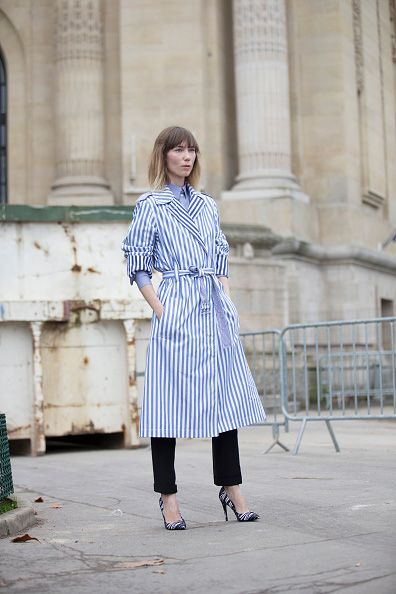 Anya Ziourova wears a Celine light blue and white striped belted dress/coat and Pierre Hardy heels at the Chanel couture show at Grand Palais on January 26, 2016 in Paris, France. (Photo by Melodie Jeng/Getty Images)