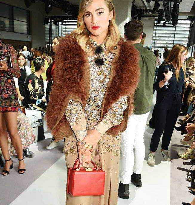 Suki Waterhouse's Grace red leather shoulder bag by Mark Cross is available at NET-A-PORTER