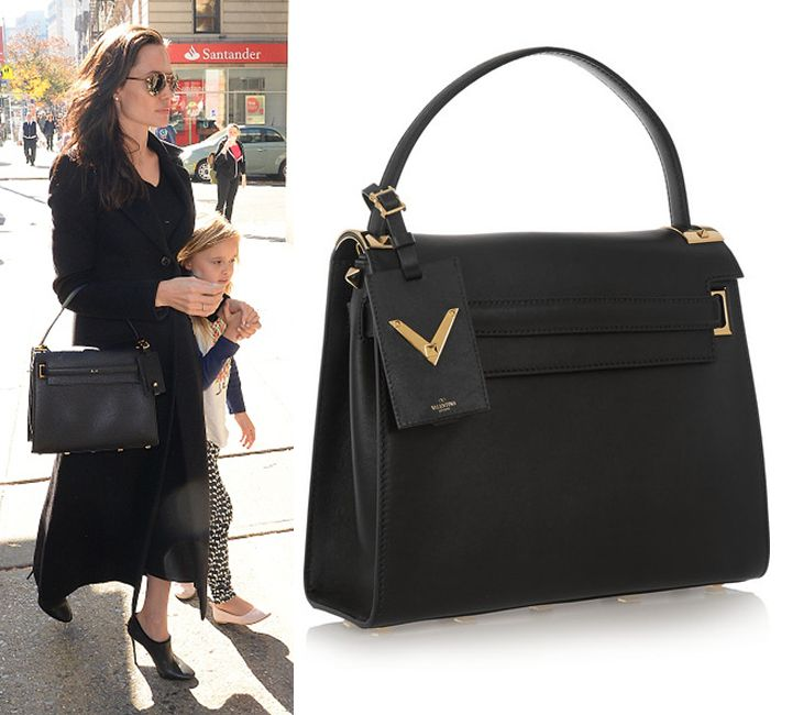 Angelina Jolie out in New York carrying a Valentino My Rockstud black leather bag that you cah buy from NET-A-PORTER