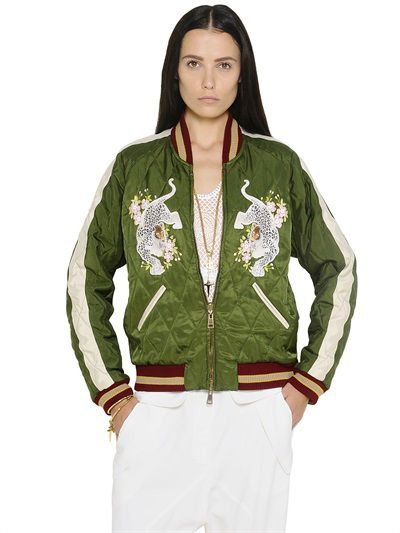 This green reversible diamond-quilted tech satin jacket embroidered with leopard appliqués is available at NEIMAN MARCUS and LUISAVIAROMA.com