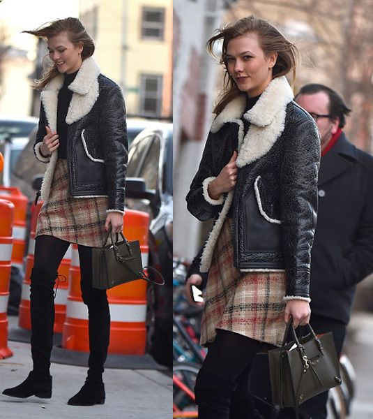 Karlie Kloss out in New York pre-Jonas storm carrying  a Balenciga Papier bag
