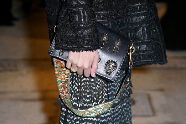 Sofia Sanchez de Betak's animal-embroidered guitar strap for handbag is available at NEIMAN MARCUS