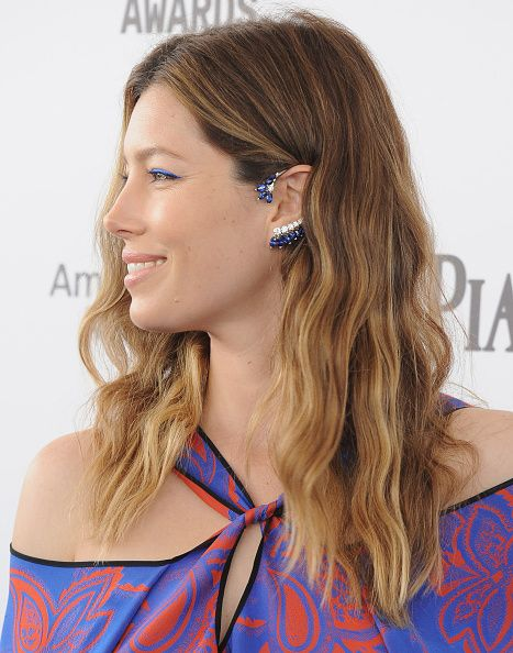Jessica Biel wears a Roland Mouret dress and Piaget ear cuff.