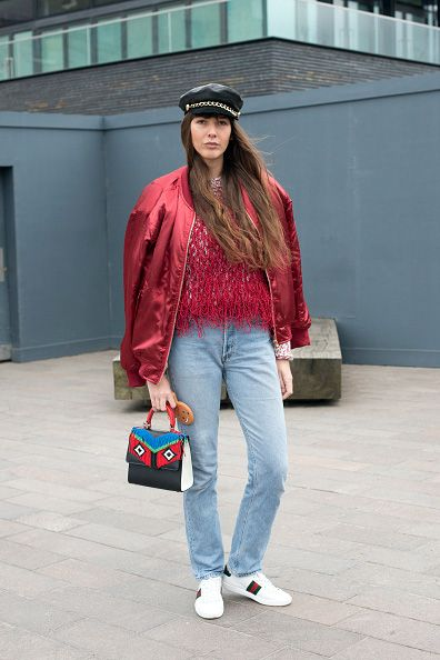 Fashion stylist Estelle Pigault wears a Pretty Little Thing jacket, Levi's jeans, Eugenia Kim hat, Gayeon Lee top, Les Petites Jouers bag and Gucci sneakers on day 3 during London Fashion Week Autumn/Winter 2016/17 on February 21, 2016 in London, England. (Photo by Kirstin Sinclair/Getty Images)