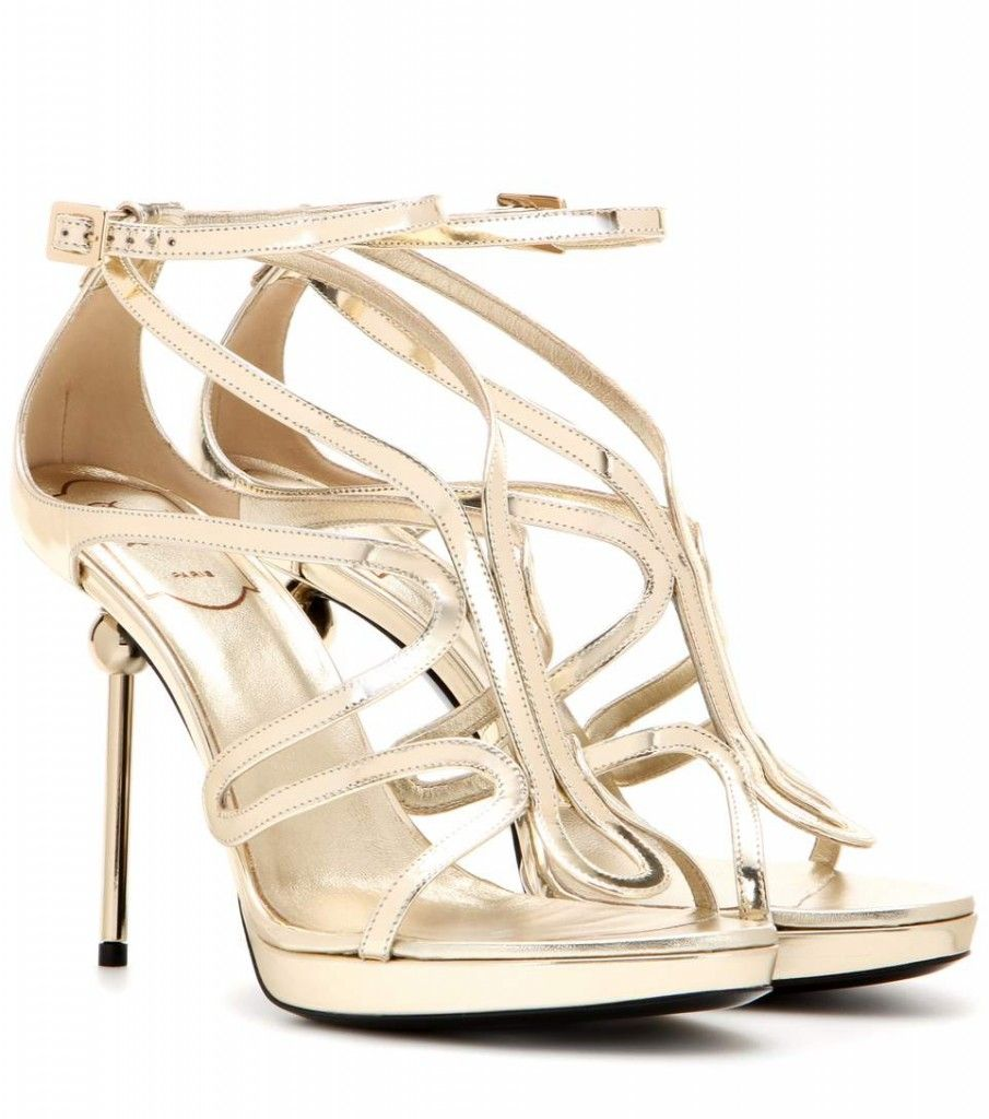 * Penelope's Roger Vivier Ondulation metallic sandals are also available at MYTHERESA.com