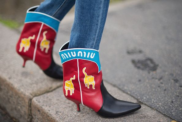 Irene Kim's Miu Miu cowbo boots are available at NET-A-PORTER