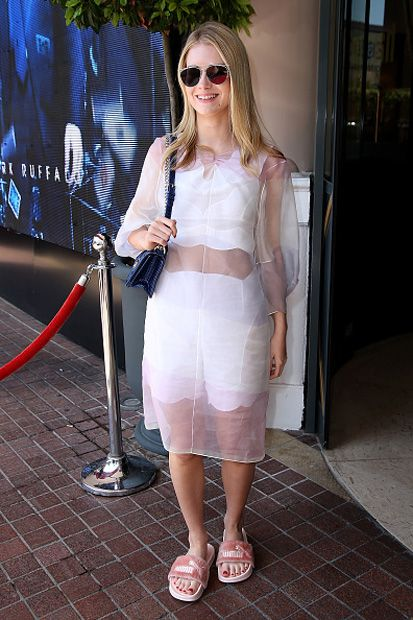 Obsessed with this look: Lottie Moss in Dior + Fenty Puma by Rihanna pink fur slide!
