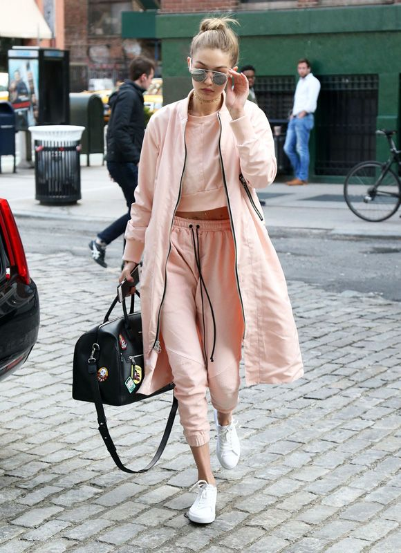 Gigi Hadid running errands out and about New York City in a peach cotton tracksuit.