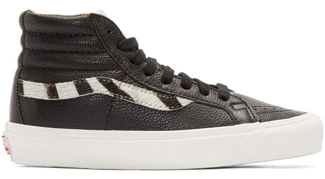 Black & White Zebra OG Sk8-Hi LX Sneakers  161739F127008 High-top grained leather sneakers in black. Perforated detailing at round toe. Tonal lace-up closure. Suede logo flag in off-white at tongue. Calf-hair panel featuring zebra pattern in black and white at sides. Padded heel collar. Rubber midsole in white featuring rubberized logo in red at heel. Rubber sole in brown. Tonal stitching.