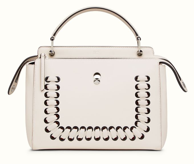 Bella is also carrying a Fendi Dotcom handbag decorated with metal eyelets and macro weave. Available at FENDI.COM