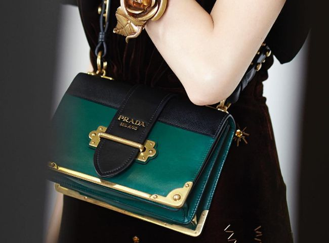 These (german) style icons love their Prada Cahier bag