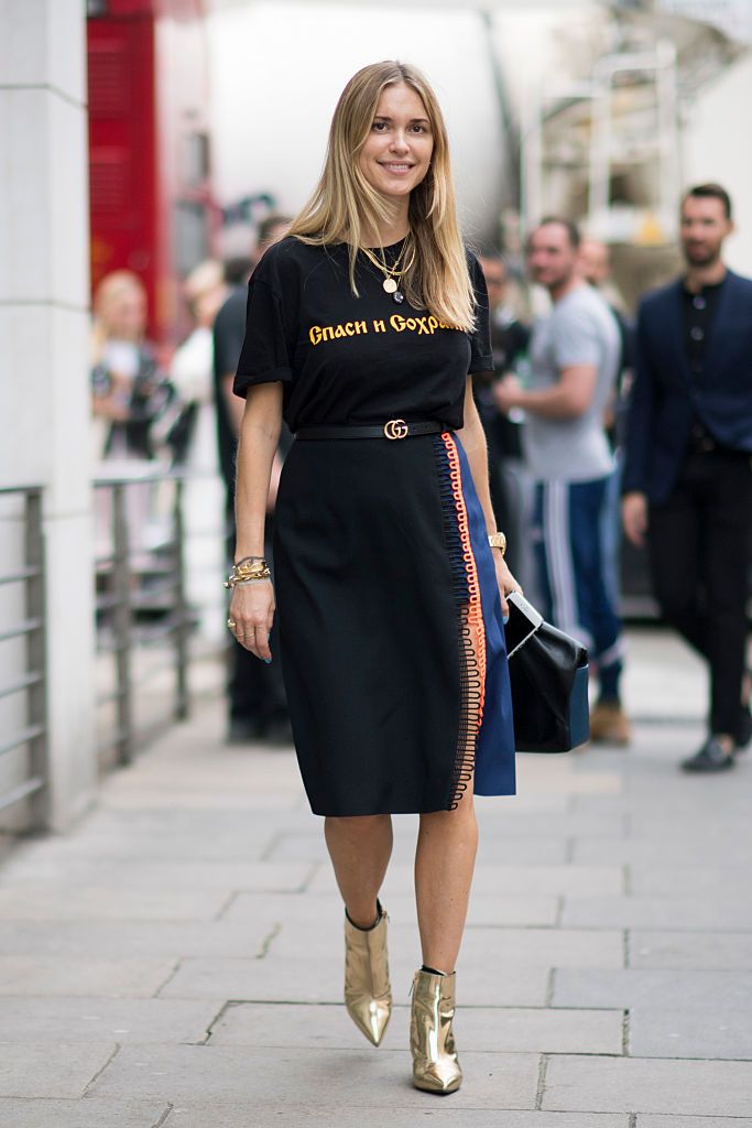 pernille-teisbaek-graphic-tee-outfit-christopher-kane-midi-skirt-balenciaga-metallic-gold-ankle-boots