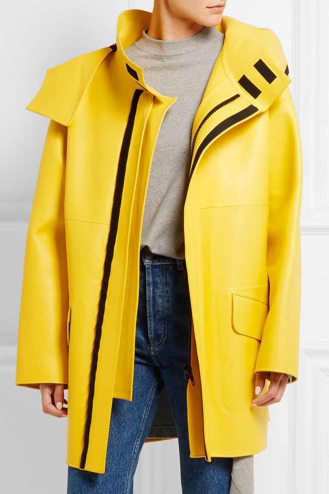 This Balenciaga yellow leather oversized jacket is available HERE