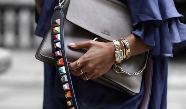 This fashion blogger knows how to make the most of an expensive designer shoulder strap