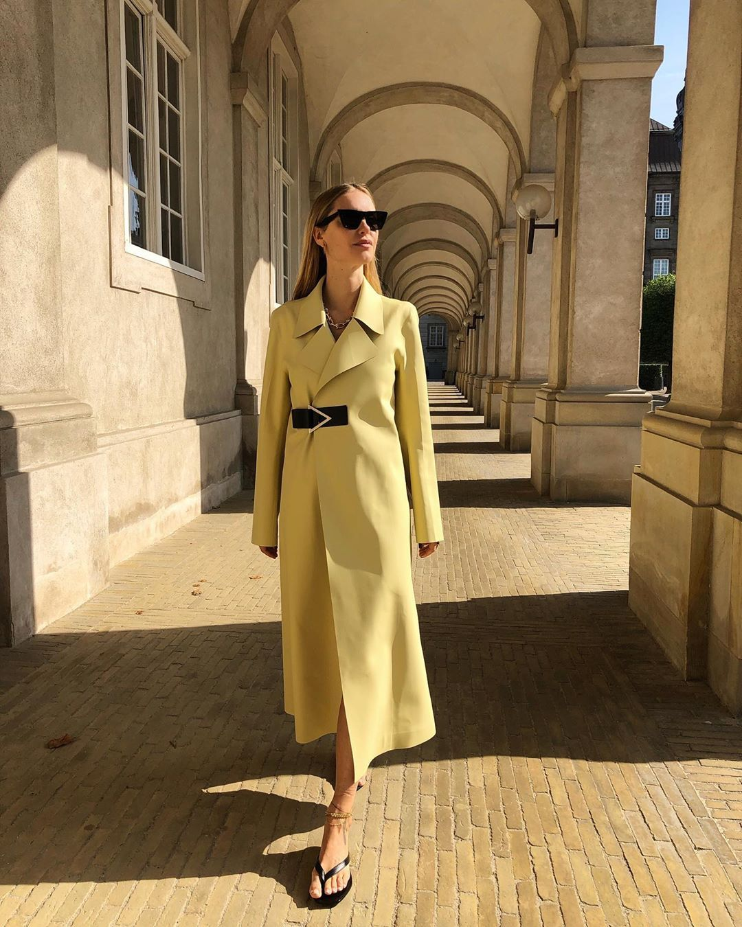 pernille-teisbaek-bottega-veneta-pale-yellow-rubber-trench-coat