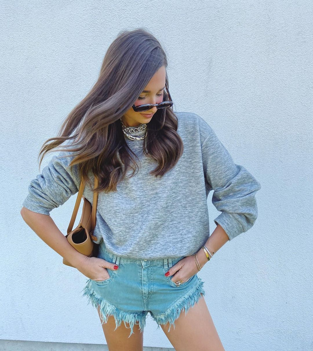 danielle-bernstein-isabel-marant-eneida-frayed-denim-shorts-gray-green-instagram