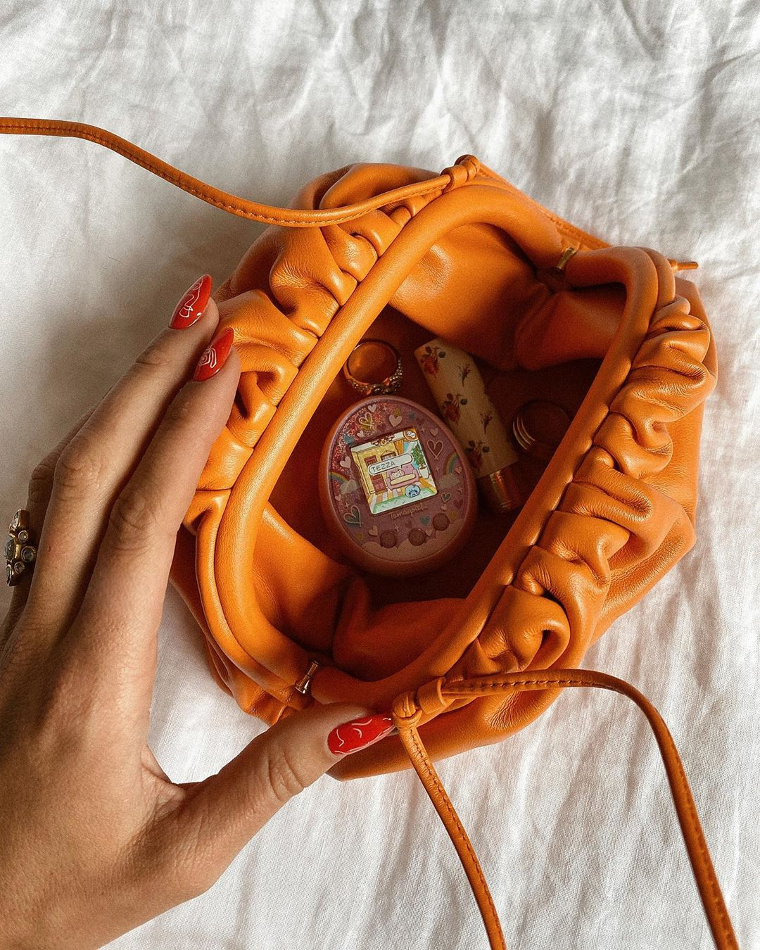 bottega-veneta-the-mini-pouch-orange-tezza-instagram